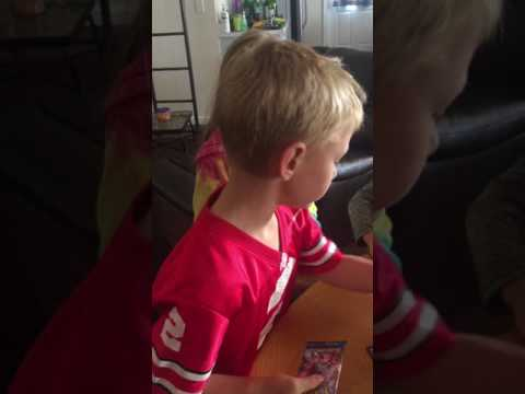 Liam versus Cole - opening Pokémon packs with Kasey