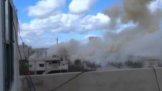Bomb lands dangeriosly  close to a Syrian Rebel