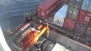 Container being loaded on a container ship
