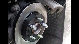 How to Replace Install rear Brakes and Rotors on a 2008 - 2012 Chevrolet Malibu