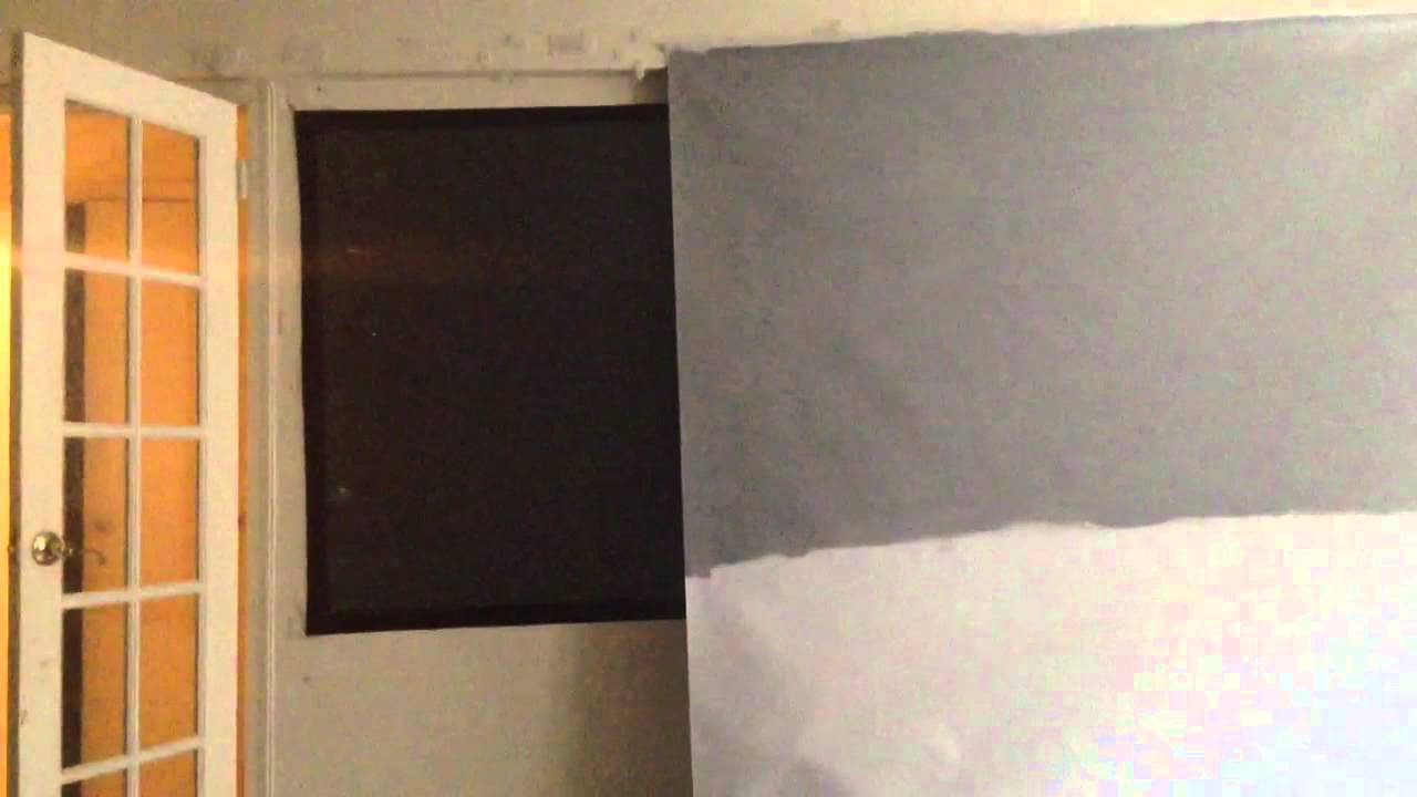 Black projector screen compared to high contrast gray
