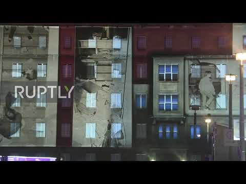 Germany: Former Stasi Headquarters Lit Up To Mark Anniversary Of Berlin Wall's Fall