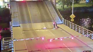 Impatient bicyclist gets stuck while trying to cross draw bridge
