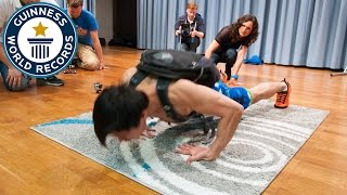 Most push ups on the back of the hands carrying a 40 lb pack in one minute - Guinness World Records