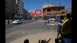 israeli missile falls from the sky towards an apartment block a few hundred metres away