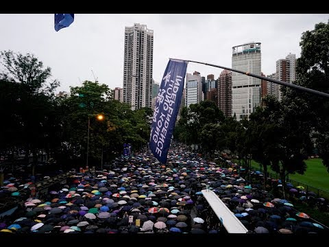 After recent chaos, Hong Kong protesters hold peaceful march