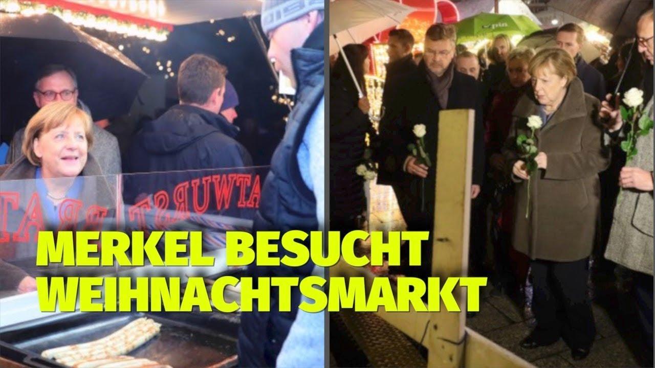 Besuch Auf Dem Weihnachtsmarkt.Angela Merkel überraschender Besuch Auf Dem Weihnachtsmarkt