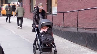 Nicky Hilton and her daughter surrounded by the Paps in New York City.