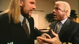 Triple H and Ric Flair discussing Batista before the contract signing for Wrestlemania 21