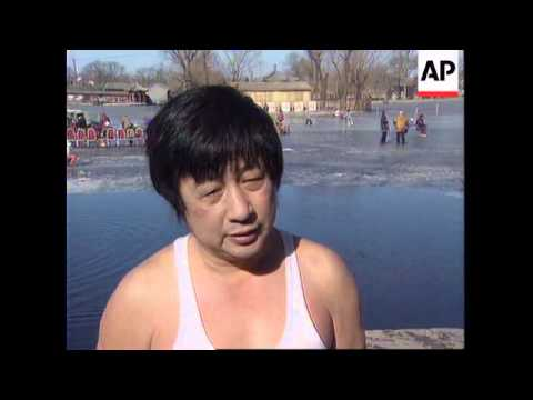 CHINA: BEIJING: SWIMMERS TAKE PLUNGE IN CITY'S FROZEN LAKES