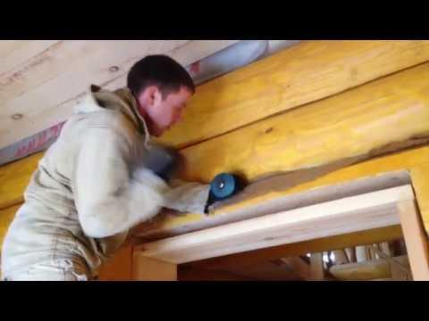 Как конопатить дом из бревна видео
