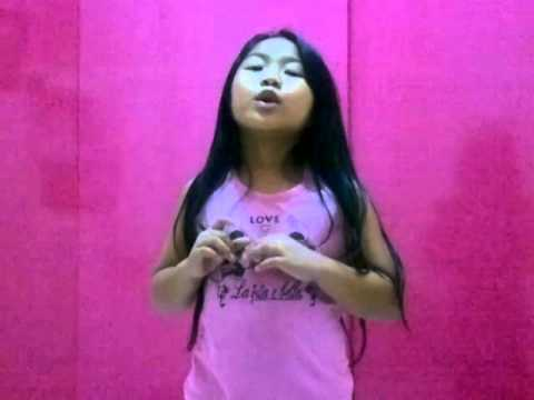 6 year old girl make up her own song on-the-spot