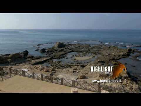 DC4K 005 G Stock footage of the ancient Caesarea ancient harbor, flying west toward the sea.