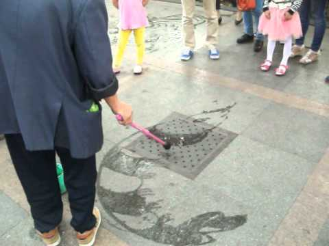 Street drawings using water on West Lake Hangzhou China