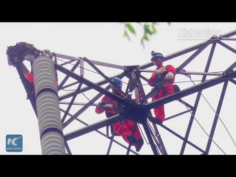 China overhauls major power transmission line