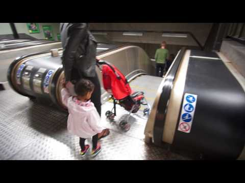 Sweden, Stockholm, Huvudsta subway station, escalator ride - going down