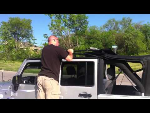 Repeat Putting the soft top down on a four door Jeep