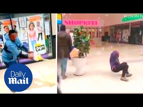 South Africa riots: Looters slip and fall after staff pour oil on mall floor