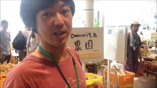Nepali student talks to vendors at Saturday Farmers' Market - Nagoya, Japan