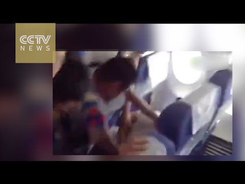 Passenger arrested after trying to break into cockpit
