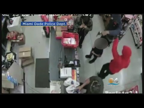 Surveillance Cameras Capture Armed Robbers Storming Family Dollar
