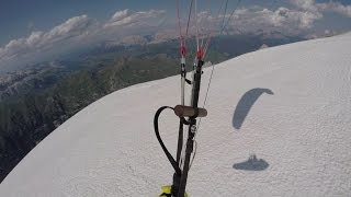 Launching  from Marmolada summit with a paraglider