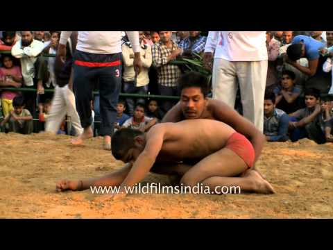 Young Indian boys battle it out in the mud : Kushti wrestling