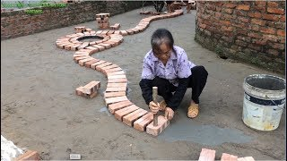 Innovative Construction Uses Bricks And Mortar To Create A Spiral Line - Building Smart Bricks
