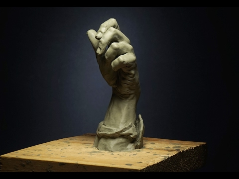sculpting a hand in clay