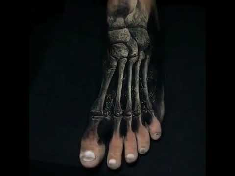 Cool black and gray skull foot tattoo