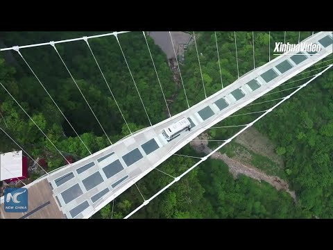 Driverless bus steers across 300m-high glass bridge in Hunan, China