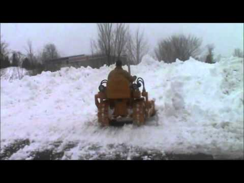 Repeat struck mini dozer pushing snow by Don Allman - You2Repeat