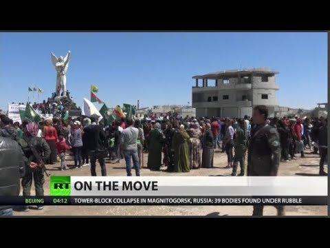 Kurdish troops begin withdrawal from Syria's Manbij