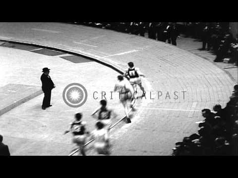 Glenn Cunningham sets a new record for indoors during Knights of Columbus games a...HD Stock Footage