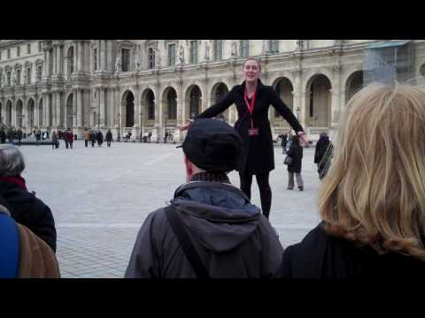 Tour Guide talking in the Louvre Courtyard