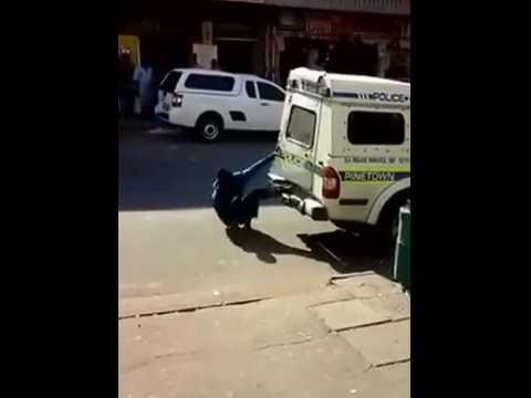 Two Men Escape from a South African Police Van #2 of 2