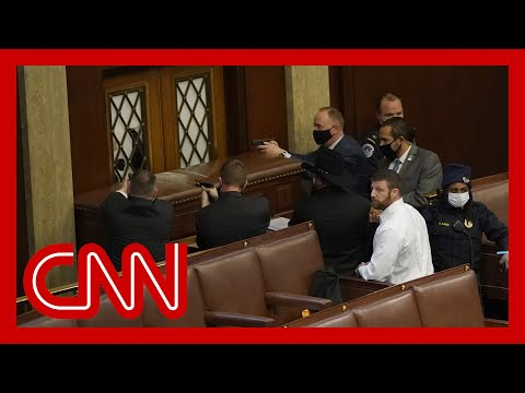 Guns drawn inside US Capitol as pro-Trump rioters invade