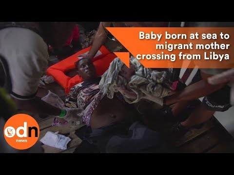 Baby born at sea to migrant mother...