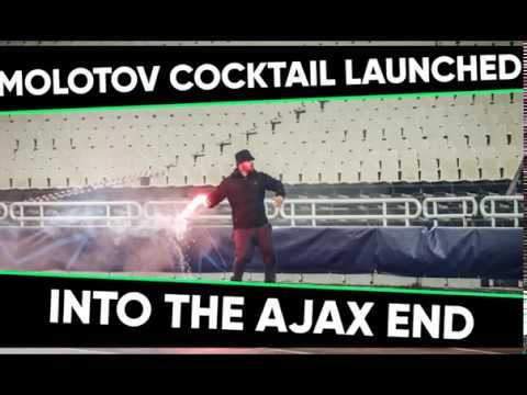 AEK ultras throw Molotov cocktail at Ajax fans during Champions League clash.