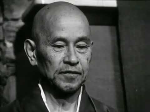 Shunryu Suzuki Roshi meditates