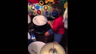2-year-old lays down steady drum beat!