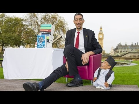World's tallest man comes eye to eye with world's smallest ...