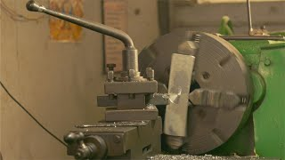 Closeup shot of an automated lathe machine in the manufacturing industry