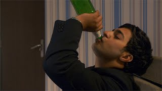 Sad, unhappy young businessman drinking alcohol or beer at home