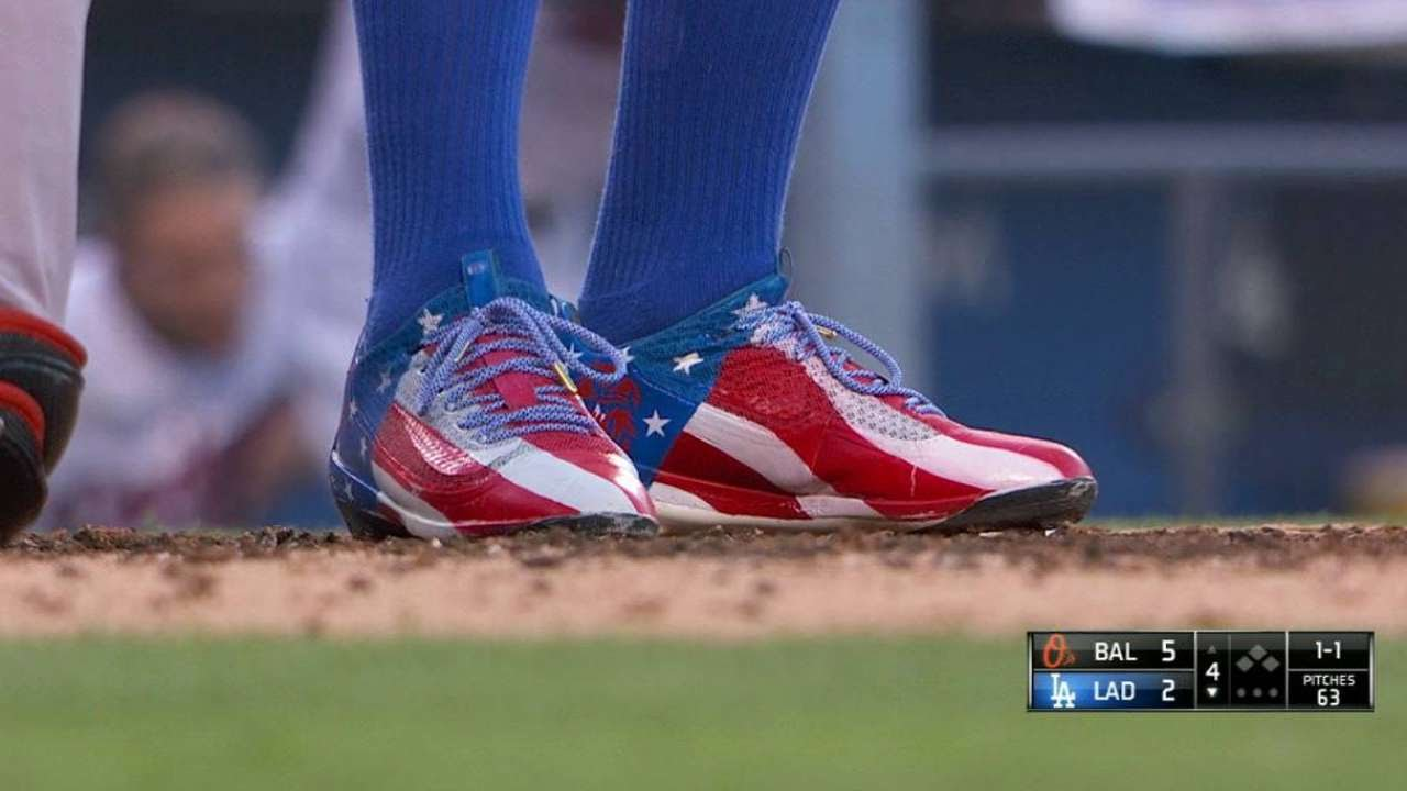 Puig rocks red, white and blue cleats