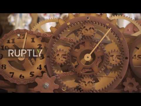 Marvel at Belarusian craftsman's spectacular wooden timepieces