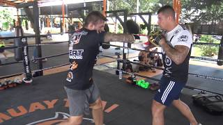 Sam Bastin punching mitts with Jesse Sanchez