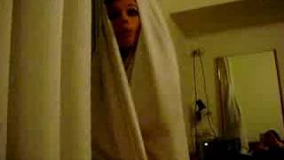 Jenny in a curtain cocoon.