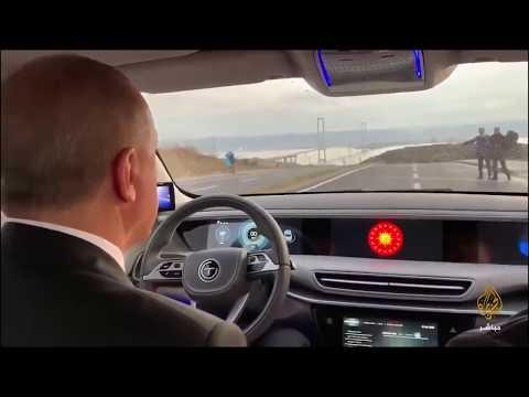 أردوغان يقود أول سيارة تركية محلية الصنع