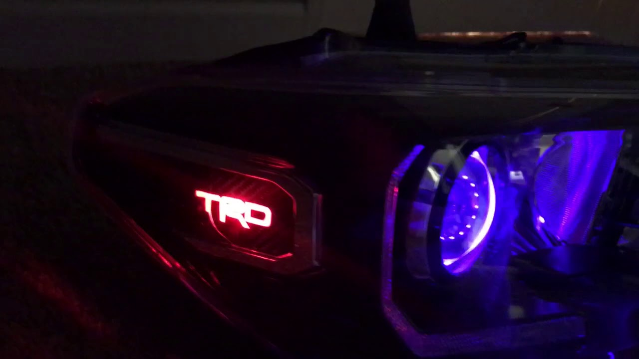 2016 - 2018 Toyota Tacoma headlight retrofitted with RGB demon eyes and TRD  logo